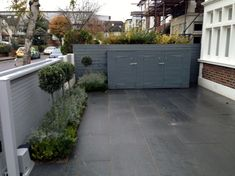 Driveway car space paving granite bike bin store white wall grey privacy screen trellis automated gates Balham Clapham Dulwich London Contact anewgarden for more information Small Front Garden Ideas Uk, Front Garden Ideas Driveway, Driveway Fence, Small Front Gardens, Terrace House Exterior, Victorian Front Garden, Bin Store, Trellis Fence, Diy Outdoor Bar
