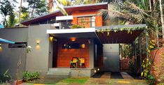 This eco-friendly house in Kannur is truly special for its cool environs both inside and outside Indian House Exterior Design, Kerala House Design, Indian Home Design, Modern Exterior, Kerala Traditional House, Traditional House Plans, Architecture Design, Kerala Architecture, Tropical Architecture