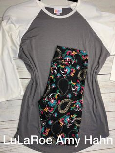 This Medium grey and white Randy is a great piece for anyone! I love adding the colorful OS leggings with it. This is super soft and stretchy material. $60 plus tax and free shipping! Shop my VIP Group for all your Comfy and Cozy LulaRoe Outfits! >>>> https://www.facebook.com/groups/lularoeamyhahn/ #lularoe #leggings #outfit #comfort #style