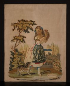 "A Young Girl Holding Her Kitten With Cat At Her Feet. A Good C19th Needlework. Measuring 22 1/2"" x 18"". Loosely Mounted On Stiff Card Covered In Parcel Paper. 