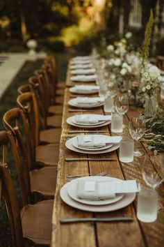 blush and grey wedding table with long wooden tables and garland.