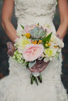 pretty pink and white bouquet with succulents | photo: rebeccaarthurs.com
