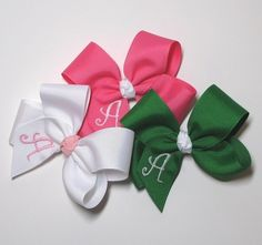 monogrammed hairbows  Adorable, reasonably priced, and made in the U.S.A..