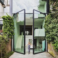 The world's largest pivoting windows designed by Sculpt IT architects for a townhouse in Antwerp, Belgium.