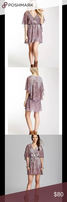 "Sparks Fly Chiffon Cape Dress Lavender Taupe Free People - Sparks Fly Chiffon Cape Dress Purple Lavender Taupe Combo   This listing is for a beautiful worn once like new condition FREE PEOPLE Sparks Fly Chiffon Cape Dress in a Purple Lavender Taupe Combo - Size Small A gossamer cape covers the shoulders of this airy floral print dress. Faux wrap neckline meets at the cinched waist for a beautifully flattering look.  Bust: 36"" Length: 34"" Waist: 26"" unstretched (stretches to ~36"") Free People…"