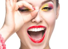 Beautiful model girl with bright colored makeup and nail polish in the summer image. Picture taken in the studio on a white background. Mascara, Eyeliner, Eyeshadow, Eyebrows, Beautiful Model Girl, White Acrylics, Summer Makeup, Insta Makeup, Bright Colors