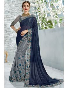 Smoke grey and midnight blue saree with blouse. Fabric - Saree : Net and shimmer ; Blouse : Raw silk and net. Work - Heavy embroidery work on saree and blouse. Paired with the matching blouse piece.Please Note: The shades may vary slightly from th Half Saree Designs, Saree Blouse Designs, Buy Designer Sarees Online, Designer Wear, Trendy Sarees, Stylish Sarees, Fancy Sarees, Sari Design, Net Blouses