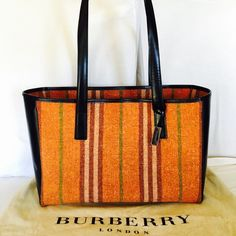 Burberry Large Tote Almost like new Burberry large tote in thick black leather and pumpkin orange checkered wool. Beautifully crafted by Burberry. This large tote is very light and durable which is practical for everyday use....you can use this as school bag or diaperbag or weekender bag! so big!...three pockets inisde....one open cellphone pocket, one snap closure large pocket and one large zippered pocket. Dustbag not included. Burberry Bags Shoulder Bags