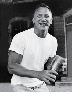 James Bond with a cigar and improvised cocktail shaker