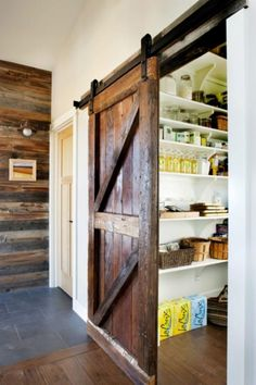 Kitchen: Traditional Wooden Sliding Barn Door Is Covering White Walk In Kitchen Pantry With Floating Shelving Organizer, Homeyapt