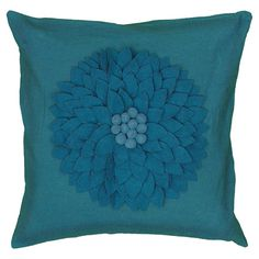 Add a stylish touch to your living room sofa or loveseat with this eye-catching pillow, featuring a textured applique.  Product: