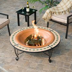 DIY portable fire pit are a popular feature in back yards throughout the country, providing outdoor meeting places throughout the year Diy Fire Pit, Fire Pit Backyard, Fire Pit Instructions, Outdoor Fire, Outdoor Decor, Washing Machine Drum, Fire Pit With Rocks, Portable Fire Pits, Fire Grill