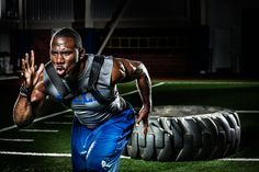 We agree: most people don't look this good pulling a tire. Click for an exclusive behind-the-scenes look at Bills running back C.J. Spiller's #Recharged photo shoot.