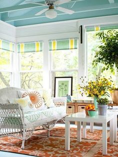 Sunroom.  white furniture, trim.  blue ceiling.  kind of like the orange accents