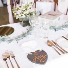 Slate heart-shaped name place cards with gold calligraphy for seating chart