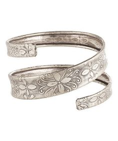 This Silvertone Floral-Embossed Spiral Cuff is perfect! #zulilyfinds
