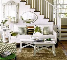 White room, green accents, sea grass rug