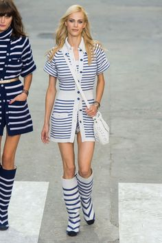 Lagerfeld paid homage to the house's own maverick woman, Coco Chanel, in the trio of navy and white striped cardigan dresses and matching knee-high boots. These were just so good and so much fun. And they segued into the parade of white blouse-and-black-skirt combinations that followed.  Imaxtree  - HarpersBAZAAR.com