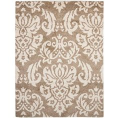 This power-loomed shag rug offers luxurious comfort and unique styling with a raised high-low pile. High-density polypropylene pile features a beige background and provides one of the most plush feels available in a rug.