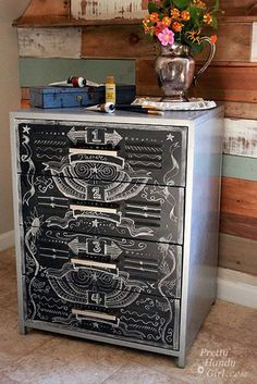 Painting Projects: A metal cabinet that's seen better days gets a second chance with some hammered metallic spray paint and chalkboard paint. By using chalkboard paint on the drawer fronts, you can have an ever-changing design. You won't believe the before on this project! Faux Zinc & Chalkboard Metal Cabinet Tutorial