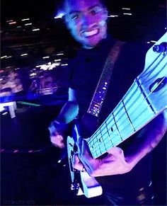 being at the top of beebs guitar at a live concert ok pls