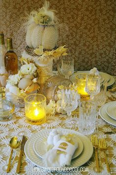 """WHITE DISHES: Yellow ( or tan) underneath white crochet lace, white pumpkins with white carnations, and crystal for a feminine touch ( love the """" hat veil"""" on the center pumpkin."""