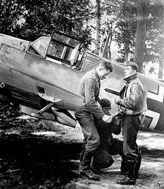 Aircraft technician help Hauptmann B. Melders wear a lifejacket before combat mission
