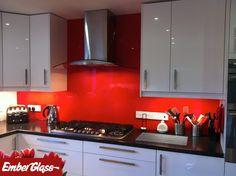 Red glass splashback. Ember Glass create bespoke glass products in any colour, pattern or image. Whether it's a splash back, worktop or table top, it's possible to personalise your glass to suit your existing decor, or taste. Visit www.glasssplashbacks.com for more inspiration!