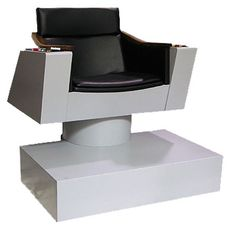 Oh, jeez. Full-size replica of the Star Trek Enterprise captain's chair. For geekly lounging.