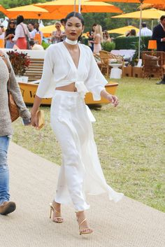 Chanel Iman looks effortlessly chic in an airy jumpsuit with tie-front details.