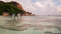 Stock Footage of Dramatic sunset timelaspe of most iconic beach in Seychelles, Anse Source d'Argent, Ladigue, golden light on granite rocks, dip to black. Explore similar videos at Adobe Stock Seychelles, Stock Video, High Quality Images, Stock Footage, Granite, Dip, Adobe, Rocks, Tropical
