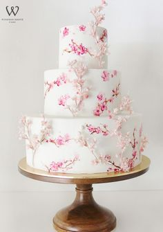 Stunning three tier pink floral printed white wedding cake; Featured Cake: Winifred Kristé Cake
