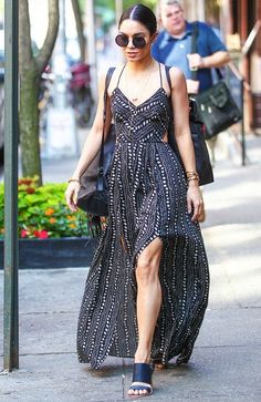 Vanessa Hudgens wears a printed, flowy maxi dress with heeled sandals and a sling bag