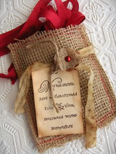 So stinkin adorable...love the coffee-stained mitten tags w/snowmen inside this cute burlap pocket