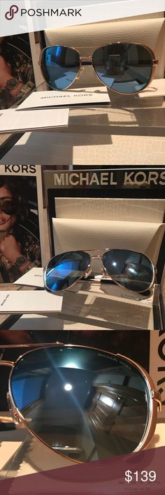 MICHAEL KORS AVIATOR SUNGLASSES NWT POLARIZED Beautiful rose gold and blue/purple mirrored polarized lenses.  Authentic Michael Kors leather case and cloth included.  Michael Kors is etched into the lenses in addition to the (P) showing polarization.  This size is perfect for most in the aviator style. Michael Kors Accessories Sunglasses