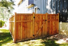 Custom cedar 6' high privacy fence with top and bottom trim detail.