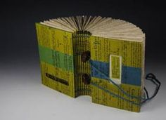 Handbound book by Mission Creek Press. 4-needle binding is a multi-gathering book that draws on the structural elements of Ethiopian and Egyptian Coptic bindings.
