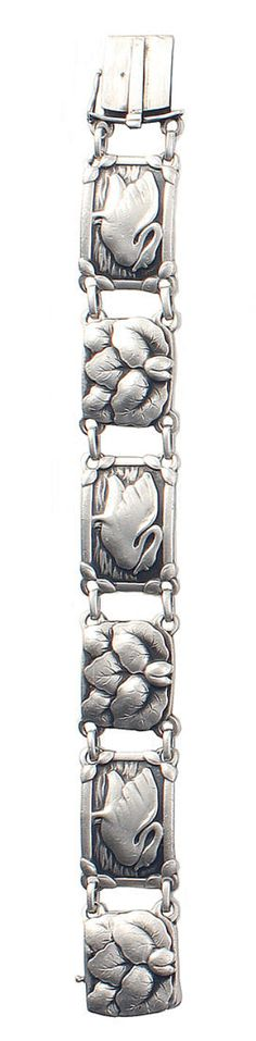 Georg Jensen  an Early Bracelet  the three rectangular links each decorated with a swan motif, alternating with square links of overlapping leaves  19cm long, numbered 42, with stamped marks for 1933-44