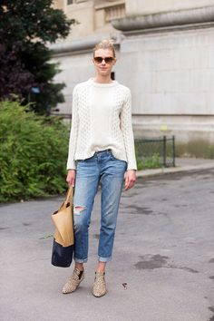 A classic fisherman sweater paired with basic jeans is nothing new or noteworthy. But look how this girl h