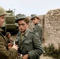 Wonderful Colorized images of D-Day German POWs captured 7 June 1944