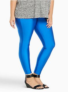 """<p>Baby, you're electric! Literally. An 80's-inspired style, the blue hue lights up on these stretchy and sheeny liquid leggings. An elastic waistband keeps your comfort level high, while the form fit and tapered leg have us ready to get physical.</p>  <ul> <li>Size 1 measures 28"""" inseam</li> <li>Nylon/spandex</li> <li>Wash cold, dry low</li> <li>Imported plus size leggings</li> </ul>  <p></p>"""