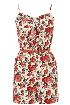 Live la vie en rose this summer in this cute floral printed cami playsuit. The piece features shoe string straps and a nipped in waist with a skinny belt to finish.