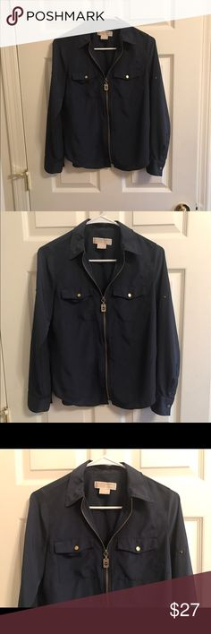 Michael Kors Zip-Front, Utility Shirt..Size SP Beautiful long sleeved, Navy blue blouse in excellent condition. It has a pointed collar. It has a front zipper closure with a kinda dog tag hardware, which is adorable! 🐾 It has roll-tab sleeves and button cuffs. Button flap pockets in the front. 100% polyester. Beautiful blouse! 👚 Michael Kors Tops Blouses