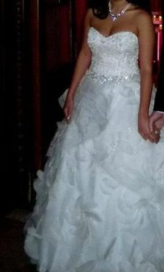 Plus size wedding dresses. Strapless wedding gowns for plus size brides. A-line style wedding dress designs. Get information about custom plus size wedding dresses and replicas at www.dariuscordell.com