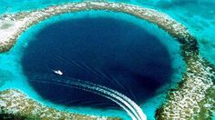 The Great Blue Hole is a large submarine sinkhole off the coast of Belize. It lies near the center of Lighthouse Reef, a small atoll 70 km from the mainland and Belize City. Belize Hotels, Belize City, Places To Travel, Places To See, Travel Destinations, Hidden Places, Winter Destinations, Great Blue Hole, Pamukkale