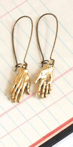 Quirky hand earrings for unique women. #hand #artist #art #nurse #nursegifts #artgift #artistgift #artgifts #artistgifts #christmas #christmasgifts #silver #gold #hands #earrings #jewelry