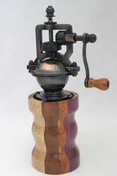 "This peppermill has an antique-style peppermill mechanism that adjusts easily from coarse to extra fine. The metal is an Antique Brass finish. It does not accommodate salt since it is metal. The body of the mill contains 20 pieces of exotic woods. It is approx. 2.5""dia. x 8""H. Cards for the Care of Wood and the names of all the woods and origin are sent with the purchase. # 615  0809"