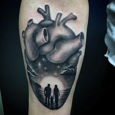 Grey Anatomical Heart With Family On A Beach Tattoo Guys Arms