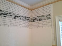 Dress up the area above your fiberglass shower insert. Featured is subway tile design with glass inserts.