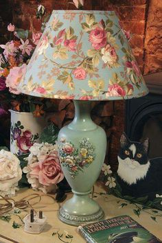Would change the lamp fabric to cream and rose colours